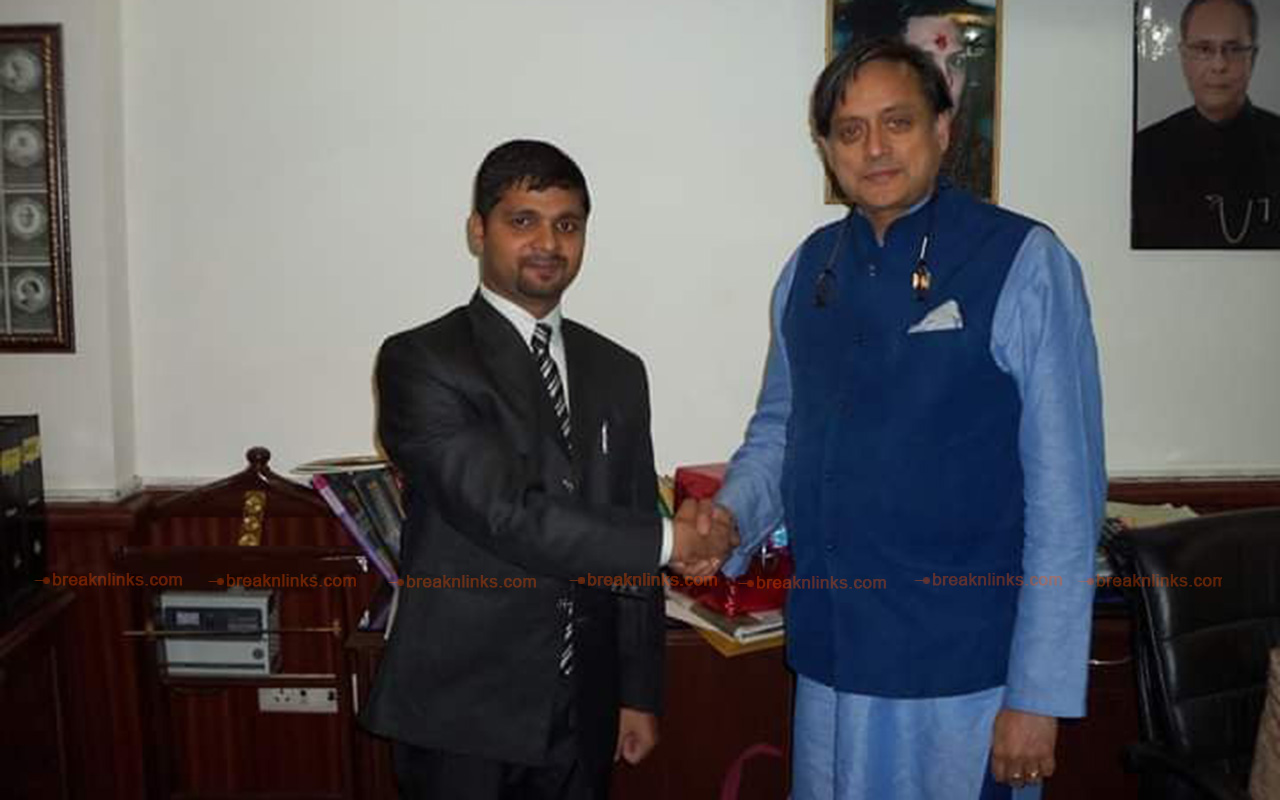 Dr. Yadav with the Indian Congress leader and scholar Sashi Tharoor