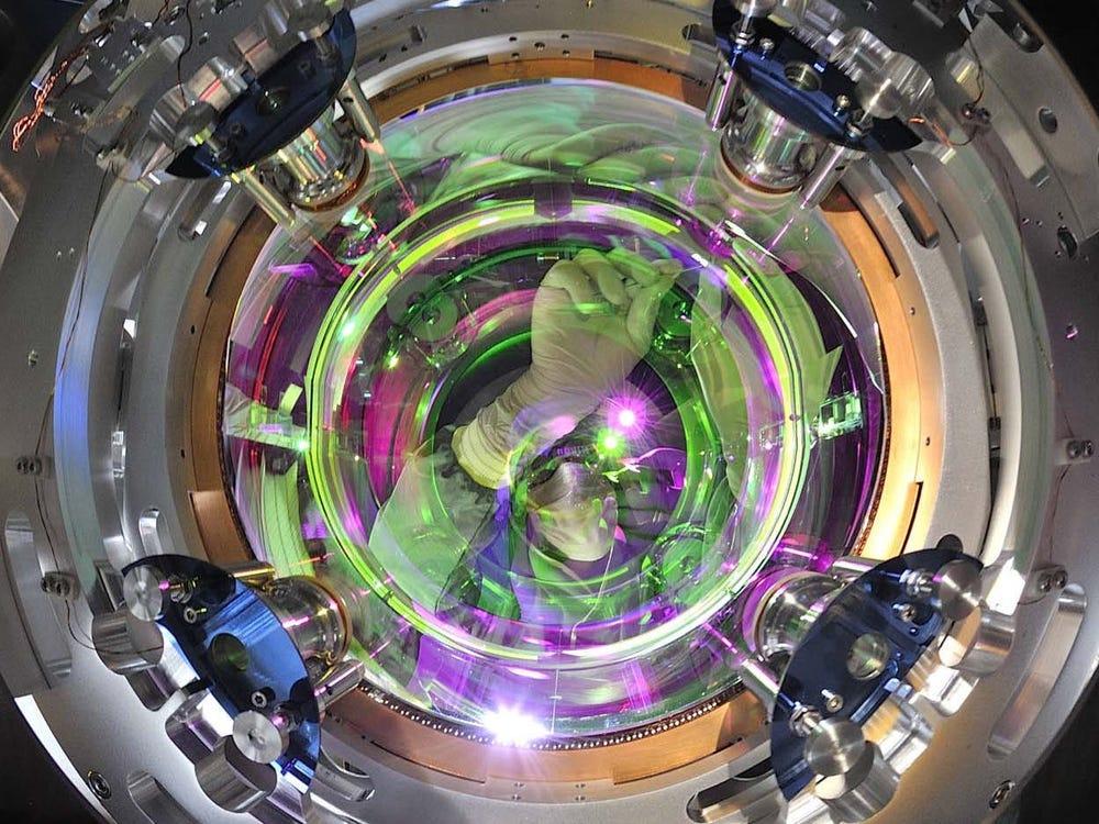 A worker inspects quartz fibers that suspend a mirror inside the Virgo gravitational-wave observatory. EGO/Virgo Collaboration/Perciballi