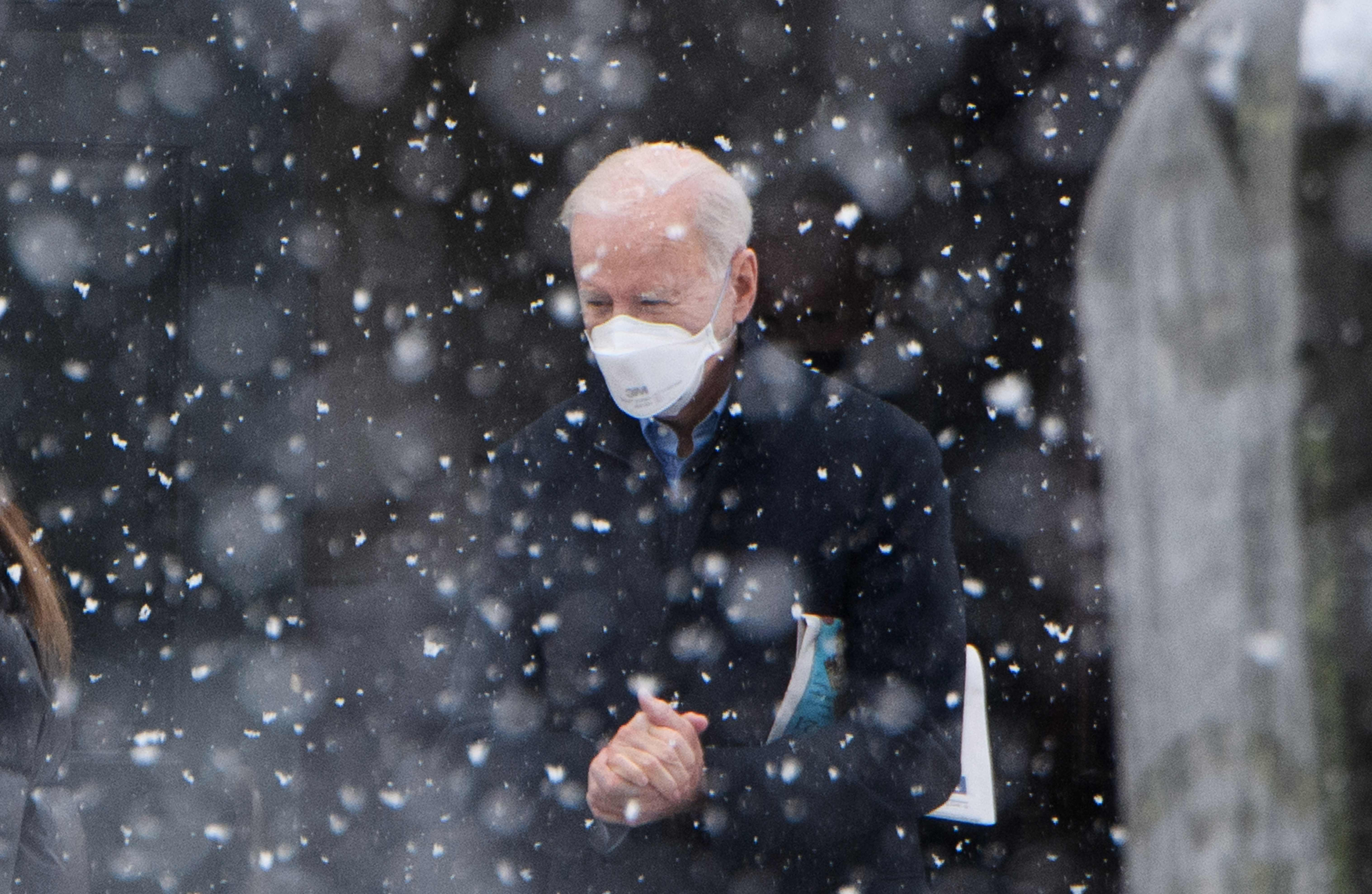 President Biden makes his way to his vehicle in the snow, after attending Mass at Saint Joseph on the Brandywine Church in Wilmington, Delaware on Febr. 7, 2021. (Mandel Ngan/AFP/Getty Images)