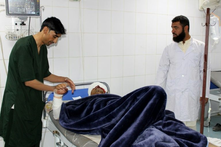 A wounded man receives medical treatment at a hospital after a car bomb attack on an Afghan police base in Khost province   (Digital Journal)